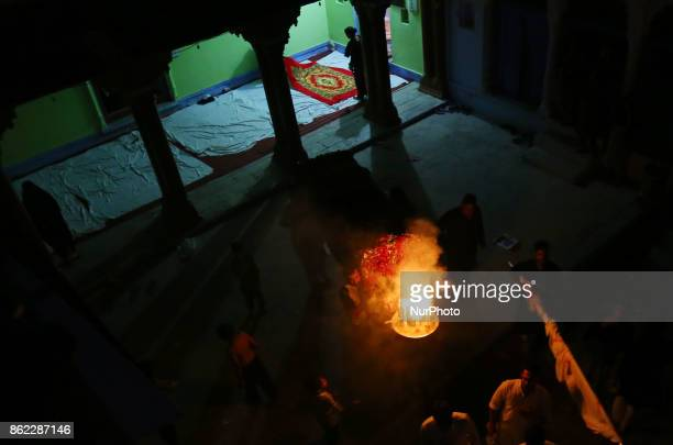 Indian shiite muslims take part in a religious procession to mark midnight Ashura procession in the old streets of Allahabad on October 172017 The...