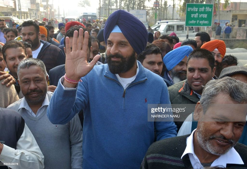 Indian Shiromani Akali Dal party candidate for Member of Legislative Assembly from Majitha Bikram Singh Majithia gestures as he leaves after casting..
