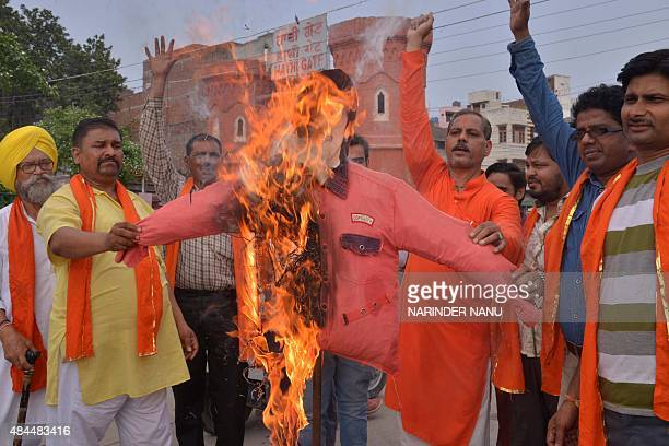 Indian Shiv Sena Samajwadi activists burn an effigy of Indian Bollywood Singer Sonu Nigam during a demonstration in Amritsar on August 19 2015...