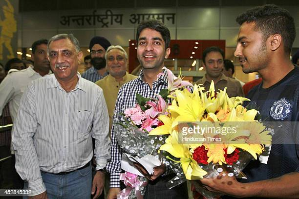 Indian shooter Abhinav Bindra receives grand welcome on his arrival at Delhi Airport after winning Gold medal in the 10m Air Rifle event during the...