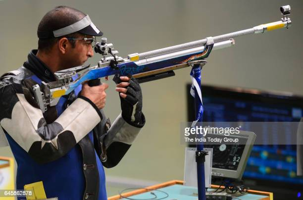 Indian shooter Ravi Kumar competes in the men's 10m air rifle shooting final during the ISSF World Cup Series 2017 in New Delhi