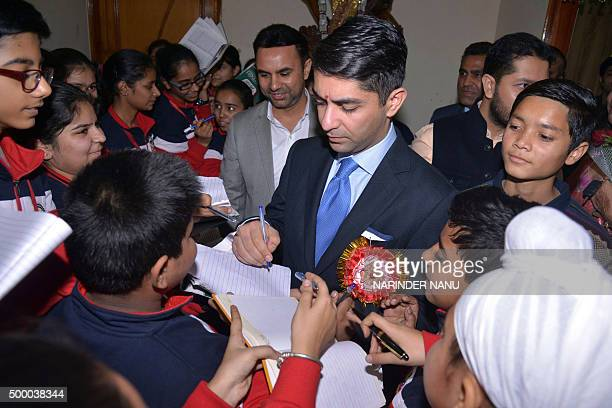 Indian shooting Olympic gold medalist Abhinav Bindra signs autographs during the opening ceremony of an indoors sports complex in Amritsar on...