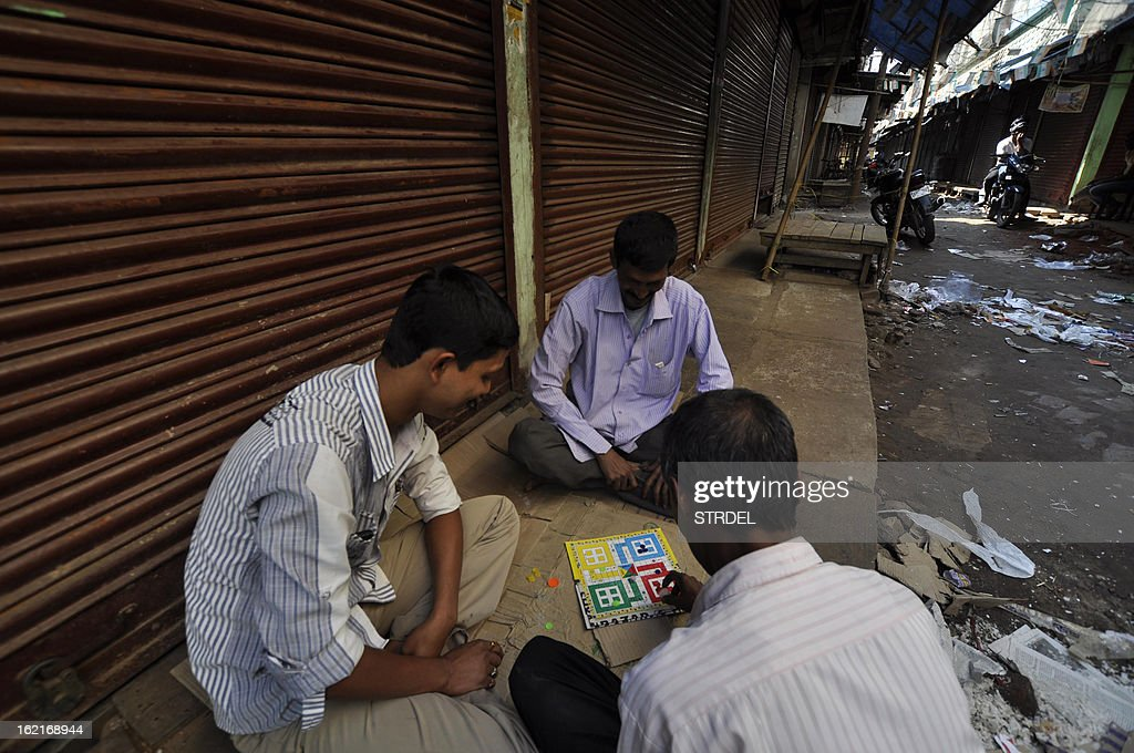 Indian shop owners play ludo inside of a closed wholesale market during a two day strike called by trade unions opposing the current UPA government's economic policies in Agartala,in the northeastern state of Tripur , on February 20, 2013. Millions of India's workers walked off their jobs in a two-day nationwide strike called by trade unions to protest at the 'anti-labour' policies of the embattled government. Financial services and transport were hit by the strike called by 11 major workers' groups to protest at a series of pro-market economic reforms announced by the government last year, as well as high inflation and rising fuel prices.