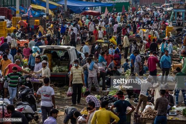 Indian shopkeepers and customers are seen in a crowded Mandi , as nationwide lockdown continues over the highly contagious novel coronavirus on March...