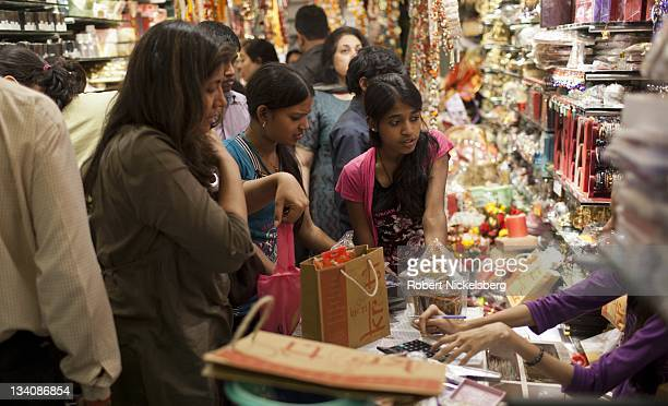 Indian shoppers make last minute purchases for Diwali gifts October 26 2011 at Khan Market in New Delhi India Popularly known as the 'festival of...