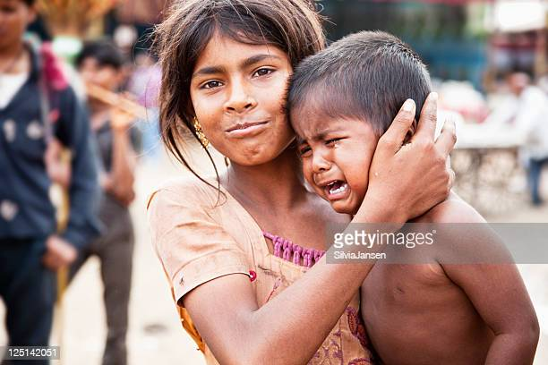 indian siblings boy crying