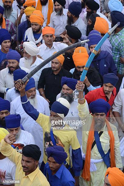 Indian Sikh activists from radical Sikh organisations shout slogans in support of Sikh leader Sant Jarnail Singh Bhindranwale and Khalistan, the name...