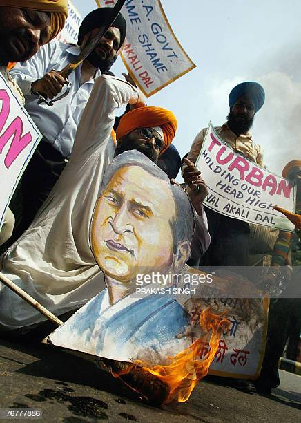 Indian Sikh activists of the National Akali Dal shout antiUS slogans while burning a poster of US President George Bush during a protest in New Delhi...