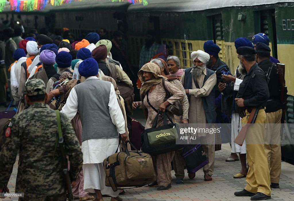 Indian Sikh devotees arrive at the Wagah railway station before clearing immigration after crossing the border at Wagah on November 12 as they arrive.