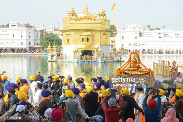 Indian Sikh devotees carry the Palki Sahib with the Guru Granth Sahib the central religious text of Sikhism during a procession on the eve of...