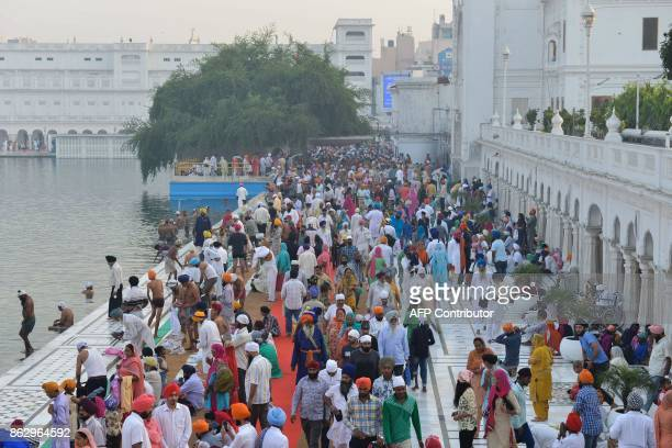 Indian Sikh devotees early morning pay respect on the occasion of Bandi Chhor Divas or Diwali at the illuminatedGolden Temple in Amritsar on October...