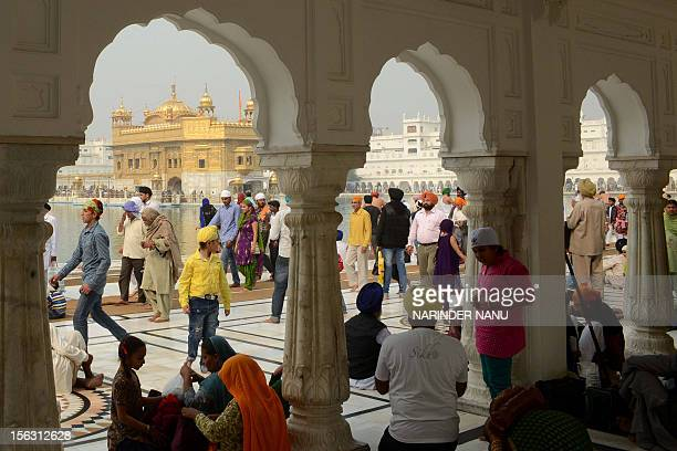 Indian Sikh devotees gather at the Golden Temple in Amritsar on November 13 on the ocassion of Bandi Chhor Divas or Diwali Sikhs celebrate Bandi...