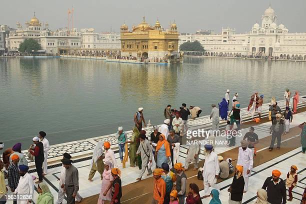 Indian Sikh devotees gather at the Golden Temple in Amritsar on November 13 on the ocassion of Bandi Chhor Divas or Diwali Sikhs celebrate Bandi...