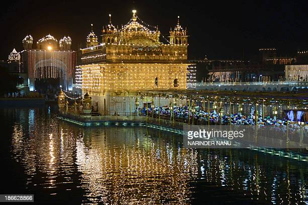 Indian Sikh devotees gather at the illuminated Sikhism's holiest shrine Golden Temple in Amritsar on November 2 on the eve of Bandi Chhor Divas or...