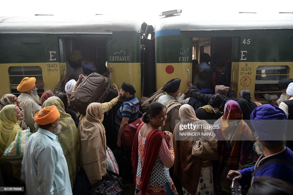Indian Sikh devotees gather at the railway station at Attari some 35kms from Amritsar on November 12 2016 as they prepare to leave on a Pakistani...