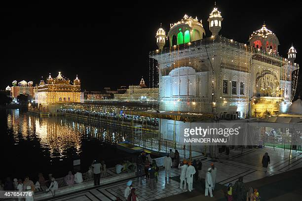 Indian Sikh devotees gather on the eve of Bandi Chhor Divas or Diwali at the Golden Temple in Amritsar on October 22 2014 Sikhs celebrate Bandi Chhor...