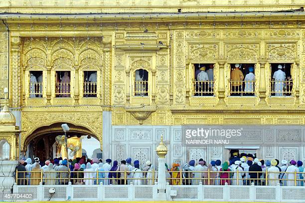 Indian Sikh devotees gather on the occasion of Bandi Chhor Divas or Diwali at the Golden Temple in Amritsar on October 23 2014 Sikhs celebrate Bandi...