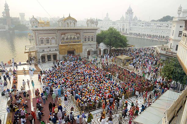 Indian Sikh devotees gather to pay respects on the occasion of Bandi Chhor Divas or Diwali at the Golden Temple in Amritsar on October 30 2016 Sikhs..