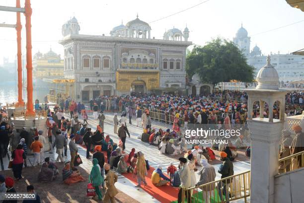 Indian Sikh devotees gather to pay their respects on the occasion of Bandi Chhor Divas at the Golden Temple in Amritsar on November 7 2018 Sikhs...