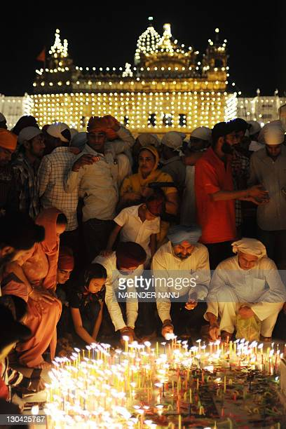 Indian Sikh devotees light candles at Sikhism's holiest shrine The Golden Temple in Amritsar on October 26 on the occasion of Bandi Chhor Divas or...