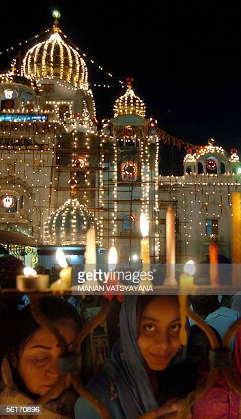 Indian Sikh devotees light candles at the Bangla Sahib Gurdwara in New Delhi 15 November 2005 to mark the 536th birth anniversary of Guru Nanak Dev...