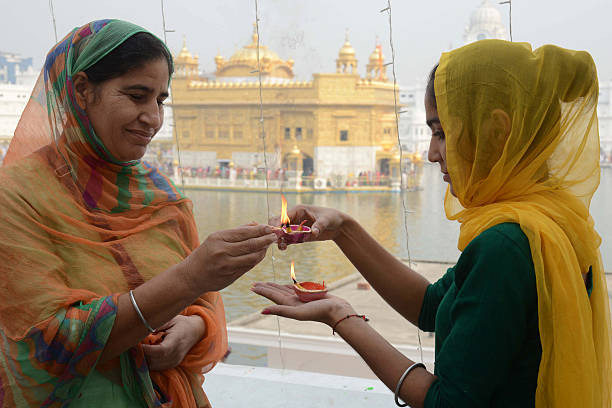Indian Sikh devotees light `diyas` as they pay respects on the occasion of Bandi Chhor Divas or Diwali at the Golden Temple in Amritsar on October 30.