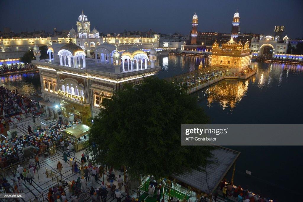 Indian Sikh devotees mark Bandi Chhor Divas or Diwali at the Golden Temple in Amritsar on October 19 2017 Sikhs celebrate Bandi Chhor Divas or Diwali.