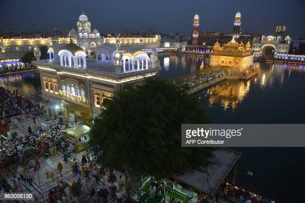Indian Sikh devotees mark Bandi Chhor Divas or Diwali at the Golden Temple in Amritsar on October 19 2017 Sikhs celebrate Bandi Chhor Divas or Diwali...