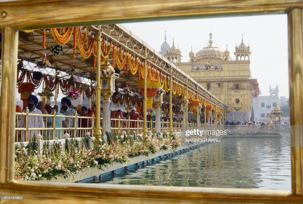 TOPSHOT Indian Sikh devotees pay respects as a `Jalau` ritual takes place inside the Sikh Shrine Golden Temple in Amritsar on October 17 2016 The...