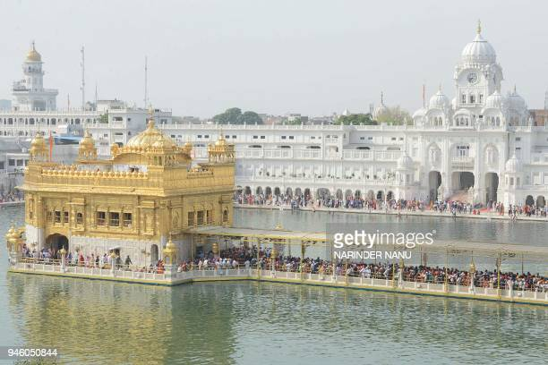 Indian Sikh devotees pay respects on the occasion of Baisakhi festival at the Golden Temple in Amritsar on April 14 2018 Baisakhi also known as...