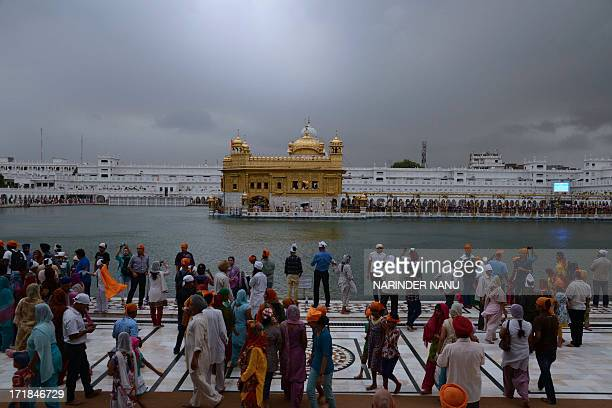 Indian Sikh devotees pay their respects at the Sikh Shrine The Golden Temple in Amritsar on June 292013 On the occasion of the 174th death...