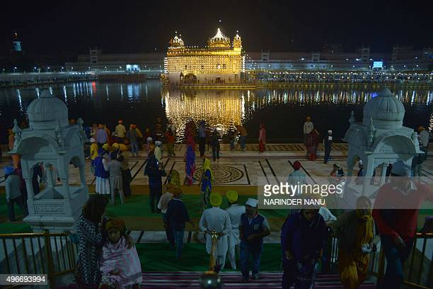 Indian Sikh devotees pay their respects on the occasion of Bandi Chhor Divas or Diwali at the illuminated Sikh shrine Golden temple in Amritsar on...