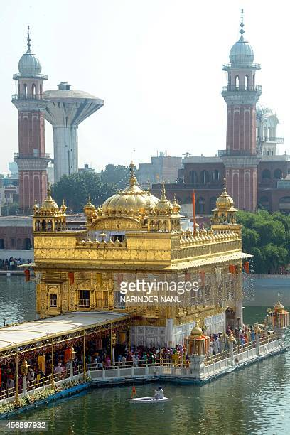 Indian Sikh devotees pay their respects to mark the birth anniversary of the fourth Sikh Guru Ramdass at the Golden Temple in Amritsar on October 9...