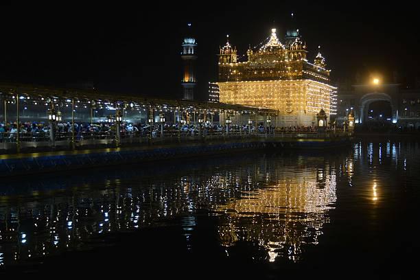 TOPSHOT Indian Sikh devotees visit the Golden Temple in Amritsar on November 13 on the eve of the 547th birth anniversary of Sri Guru Nanak Dev Guru..