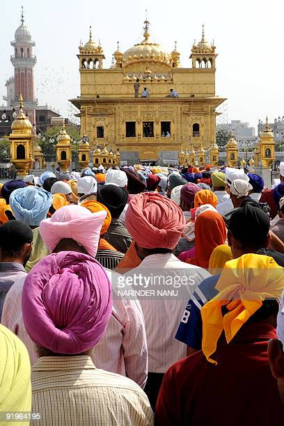 Indian Sikh devotees wait for their turn to pay respects inside the Golden Temple on the occasion of Bandi Chhor Divas or Diwali in Amritsar on...