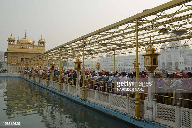 Indian Sikh devotees wait in line to visit the the inner sanctum of the Golden Temple in Amritsar on November 13 on the ocassion of Bandi Chhor Divas...