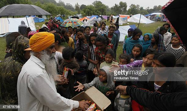 Indian Sikh distributing dry food and biscuit to the Nepal earthquake victims at their Makeshifts tents, near Pashupatinath temple bus stand on April...