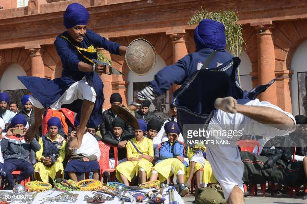 TOPSHOT Indian Sikh participants perform 'Gatka' an ancient form of Sikh martial art during a competition in Amritsar on January 20 2018 Gatka is a...