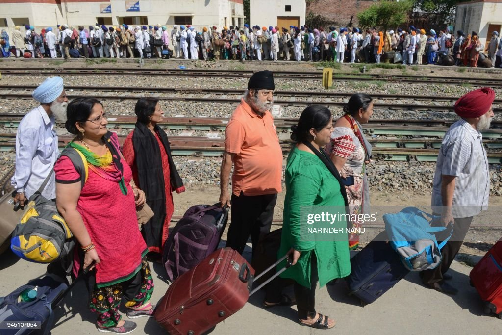 Indian Sikh pilgrims arrive at Attari Railway Station before leaving on special train service to Lahore to celebrate the Baisakhi festival in...