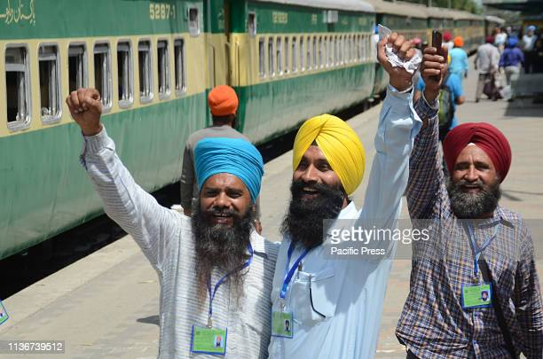 Indian Sikh pilgrims arrived and waving their hands at Wagah Border Railway Station on Friday from India to participate in the annual Baisakhi...