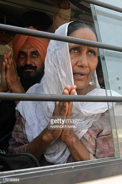 Indian Sikh pilgrims pose as they sit on a bus before departing to Pakistan at the Golden Temple complex in Amritsar on June 8 2013 Hundreds of Sikh...