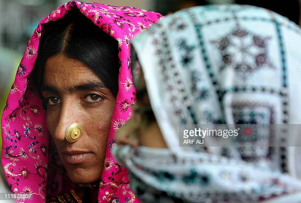 Indian Sikh pilgrims wait in line at Pakistani immigration post upon their arrival at the Wagah railway station on April 11 2011 Thousands of Indian...