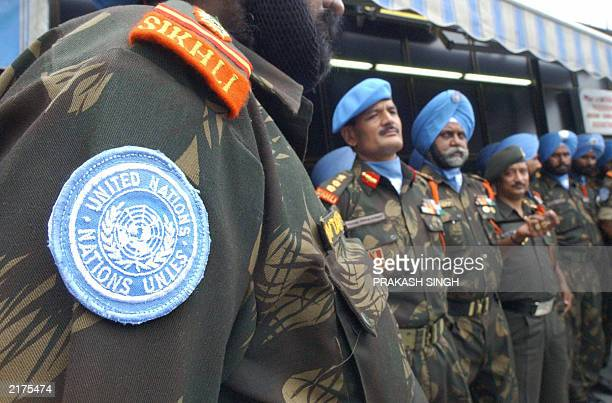 Indian Sikh soldiers of 15 Sikh Light Infantary stand in one line at the Indira Ganghi International airport in New Delhi 16 July 2003 before their...