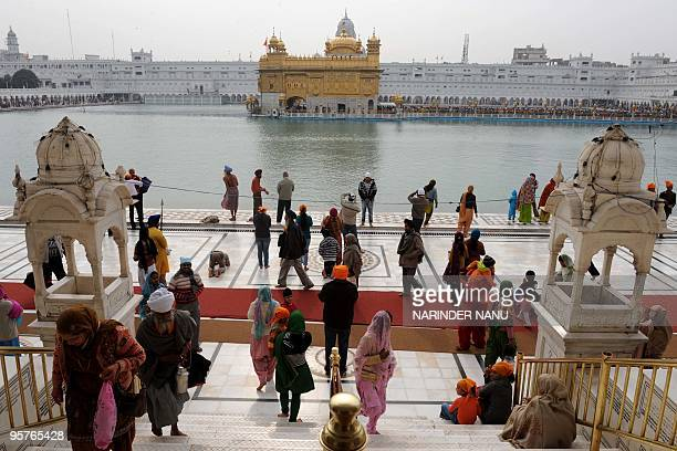 Indian Sikhs pay homage on the occasion of Maghi Mela at the Golden Temple in Amritsar on January 14 2010 Maghi Mela follows the Lohri or harvest...