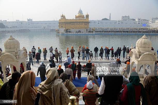 Indian Sikhs pay their respects during the Maghi Mela at the Sikh Shrine Golden Temple in Amritsar on January 13 2013 The Maghi Mela follows the...