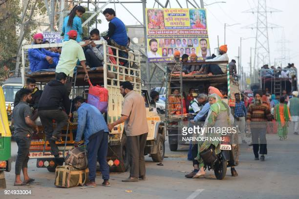 Indian Sikhs sit in mini trucks as they prepare to travel to Anandpur Sahib for the upcoming Hola Mohalla festival in Amritsar on February 27 2018...