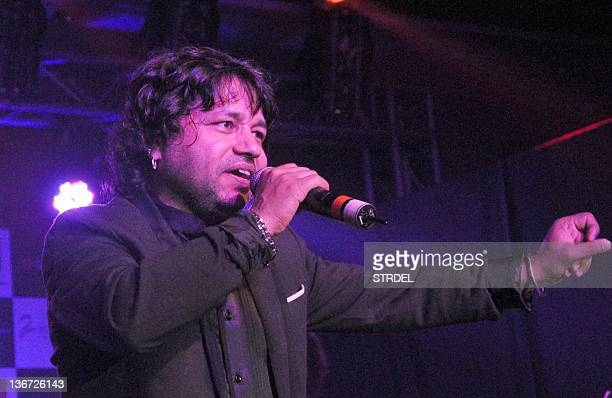 """Indian singer Kailash Kher performs during the release of his new album """"Kailasha Rangeele"""" in Mumbai on January 10 2012 AFP PHOTO / STR"""