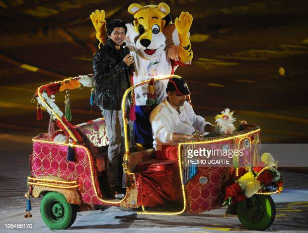 Indian singer Shaan and Games Mascot Shera perform on an autorickshaw during the Commonwealth Games closing ceremony at the Jawaharlal Nehru stadium...