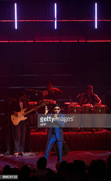 Indian singer Shaan performs onstage with 'The Groove' on Indian Voices day during the BBC Proms 2009 at the Royal Albert Hall London on August 16...