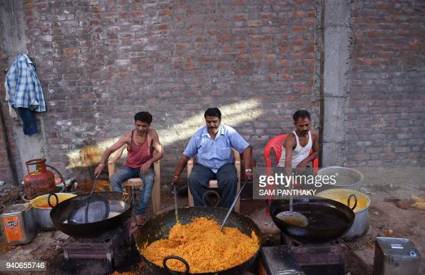 Indian skilled Laddoo makers prepare laddoos in Ahmedabad on April 1 2018 Some 1500 Kg of laddoos are being prepared to be offered to the devotees...